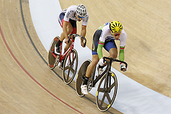 Great Britain's Kian Emadi-Coffin rides behind Wales' Jonathan Mould (right) during the Men's Scratch Race during day two of the UCI Track Cycling World Cup at the Sir Chris Hoy Velodrome, Glasgow.
