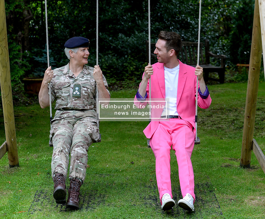 Pictured: Performer Nick Alban, from show the Happiness Prohect chats to Brigadier Suzanne Anderson.<br /> <br /> The Army at the Fringe venue opened it's doors today, with five shows on. <br /> <br /> © Dave Johnston / EEm