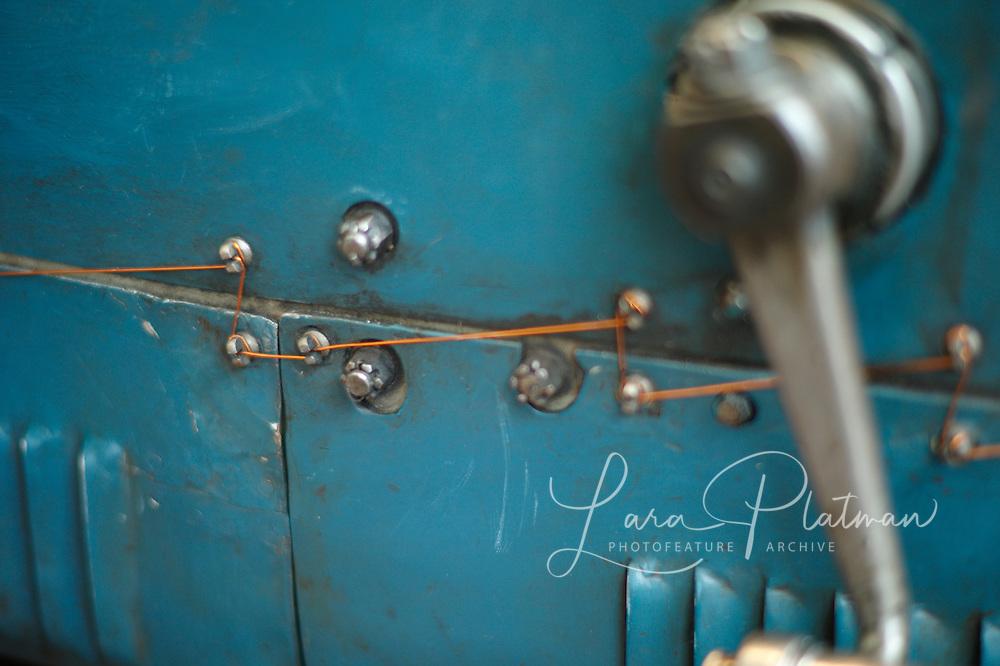 7th Grand Prix de Monaco Historique The careful copper stitching on the Bugatti Type 35 1925 to secure the bolts onto the Aluminium body