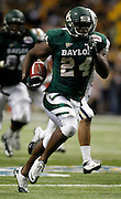 Baylor's Terrance Ganaway breaks off a huge run during game action against Washington of the 2011 Valero Alamo Bowl at the Alamodome in San Antonio, Texas on Friday, Dec. 30, 2011. Baylor won 67-56.
