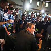 While his quarterback, Brett Hundley, fields questions on the other side of the room, UCLA football coach Jim Mora holds court at the Pac12 media day.