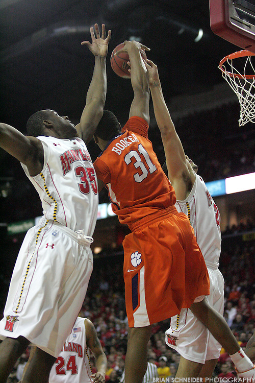 Jan 22, 2011; College Park, MD, USA; Clemson Tigers guard Devin Booker (31) and Maryland Terrapins forward James Padgett (35) and forward Jordan Williams (20) go for a rebound during the second half at the Comcast Center. Mandatory Credit: Brian Schneider-www.ebrianschneider.com