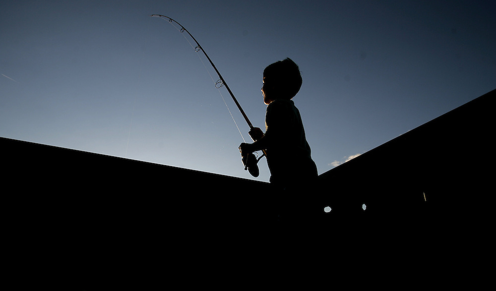 Irvington, NY / 2008 - Michael Nadasi, 5, enjoys an afternoon of fishing at Scenic Hudson Park at Irvington Park August 19.  ( Mike Roy / The Journal News )