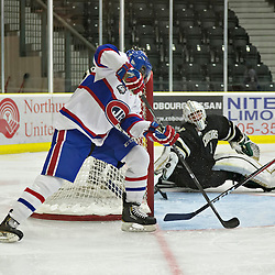 COBOURG, ON - Oct 21 : Ontario Junior Hockey League Game Action between Cobourg Cougars Hockey Club & Toronto Junior Canadiens Hockey Club, Mathieu Ouellet #1 of the Cobourg Cougars Hockey Club makes the save<br /> (Photo by Dave Powers / OJHL Images)