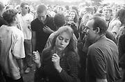 Ravers enjoying the tunes in the sunlight, Ashton Court Festival, Bristol, UK, 1995.