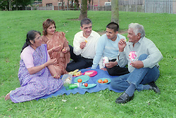 Family enjoying a picnic in the park,