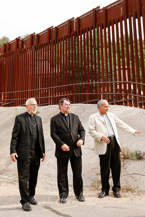 Bishop Gerald F. Kicanas of Tucson, Arizona; Archbishop Christophe Pierre, apostolic nuncio to the United States; and Bishop Jose Leopoldo Gonzalez-Gonzalez of Nogales, Sonora, arrive at the international border fence in Nogales, Arizona, to celebrate Mass Oct. 23. Dioceses Without Borders, an effort of the dioceses of Nogales, Tucson and Phoenix, organized the liturgy celebrated on both sides of the U.S.-Mexico border. (CNS photo/Nancy Wiechec)