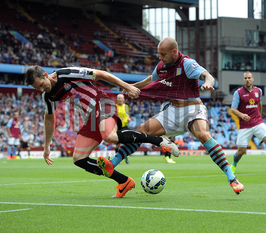 Aston Villa's Alan Hutton battles for the ball with Newcastle United's Michael Williamson - Photo mandatory by-line: Joe Meredith/JMP - Mobile: 07966 386802 23/08/2014 - SPORT - FOOTBALL - Birmingham - Villa Park - Aston Villa v Newcastle United - Barclays Premier League