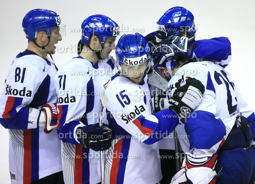 Team Slovakia: Marcel Hossa (81), Juraj Mikus (71), Dominik Granak (15) and Goalkeeper Jan Lasak of Slovakia celebrate victory at ice-hockey game Slovenia vs Slovakia at second game in  Relegation  Round (group G) of IIHF WC 2008 in Halifax, on May 10, 2008 in Metro Center, Halifax, Nova Scotia, Canada. Slovakia won after penalty shots 4:3.  (Photo by Vid Ponikvar / Sportal Images)