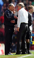 Tottenham Hotspur manager Martin Jol comes face to face with Arsenal manager Arsene Wenger.