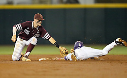 Texas A&M's Austin Homan (25) tags out TCU's Ryan Merrill (5) as he attempts to steal second base during the third inning of a NCAA college baseball Super Regional tournament game, Saturday, June 11, 2016, in College Station, Texas. (AP Photo/Sam Craft)