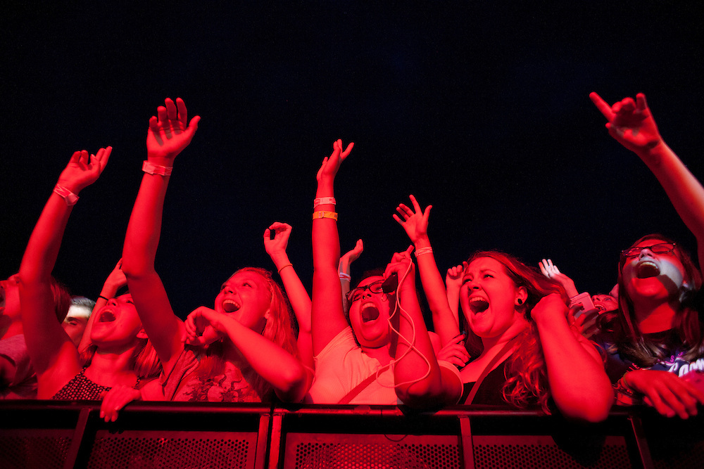 Fans scream as Young the Giant performs at the NewBo Music Fest in downtown Cedar Rapids on Saturday, August 8, 2015. Many of the people in the first rows of the crowd had held their places all day, waiting out clouds, rain, sun and heat to have a front-row seat to the shows. (Rebecca F. Miller/Freelance for the Gazette)