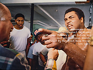 Muhammad Ali, photographed in Miami in Angelo Dundee's gym before his last professional match, being intervied by Heywood Hale Broun (on left).