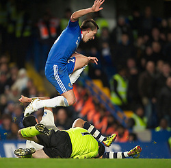 LONDON, ENGLAND - Saturday, December 4, 2010: Everton's Tim Cahill clatters into Chelsea's goalkeeper Petr Cech during the Premiership match at Stamford Bridge. (Pic by: David Rawcliffe/Propaganda)