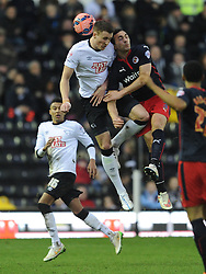 Derby Craig Forsyth holds of Reading Stephen Kelly, Derby County v Reading, FA Cup 5th Round, The Ipro Stadium, Saturday 14th Febuary 2015