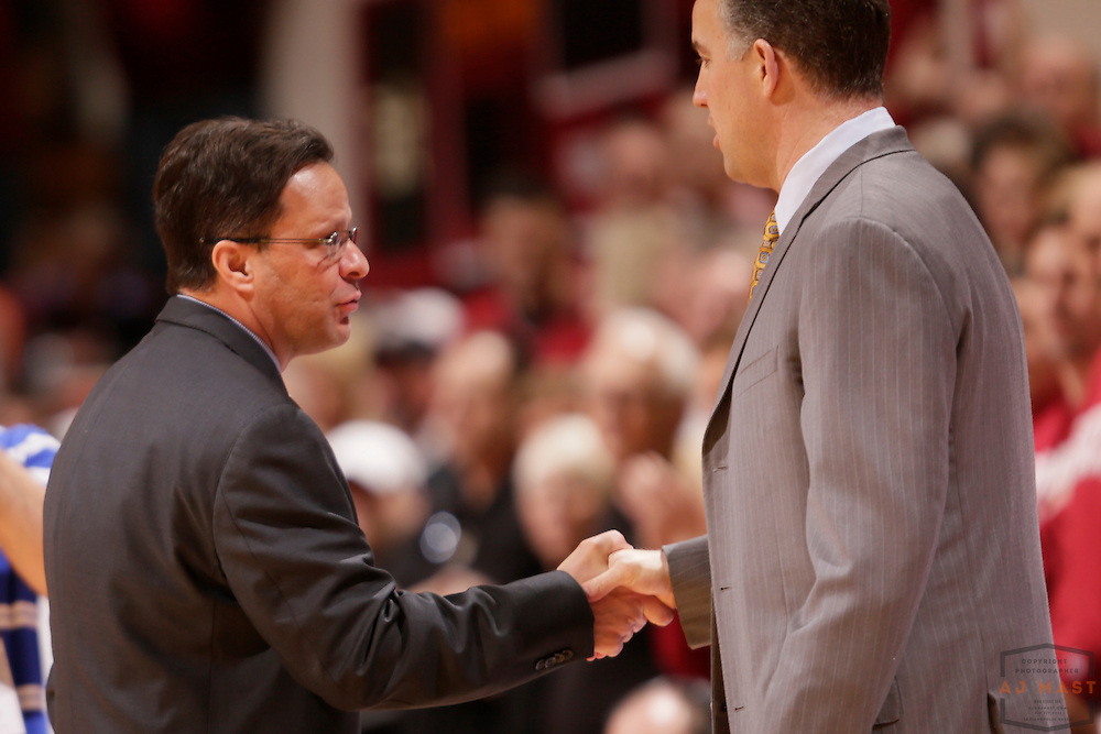 16 February 2013: Indiana head coach Tom Crean shakes hands with Purdue Boilermakers head coach Matt Painter  as the Indiana Hoosiers played the Purdue Boilermakers in a college basketball game in Bloomington, Ind.