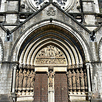 Tympanum of Saint Fin Barre&rsquo;s Cathedral in Cork, Ireland<br /> There have been three churches on this site going back 1,400 years. Saint Finbarr built the first early in the 7th century. It is assumed he is buried nearby. A medieval cathedral was demolished in 1785 yet the west tower remains.  It was followed by another cathedral that was poorly regarded and torn down in the early 1860s. The current cathedral was started in 1865. By the time it was finished in 1879, it exceeded the budget by almost seven times.  These impressive tympanums feature the following scenes (left to right): Expulsion from Paradise, The Last Judgement and Abraham Sacrificing Isaac.