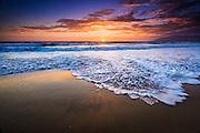 Sunset over the Pacific Ocean from Ventura State Beach, Ventura, California USA
