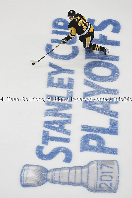"PITTSBURGH, PA - APRIL 12: Pittsburgh Penguins Center Evgeni Malkin (71) skates across the ""Stanley Cup Playoffs"" logo before Game One of the Eastern Conference First Round during the 2017 NHL Stanley Cup Playoffs between the Columbus Blue Jackets and the Pittsburgh Penguins on April 12, 2017, at PPG Paints Arena in Pittsburgh, PA. (Photo by Jeanine Leech/Icon Sportswire)"