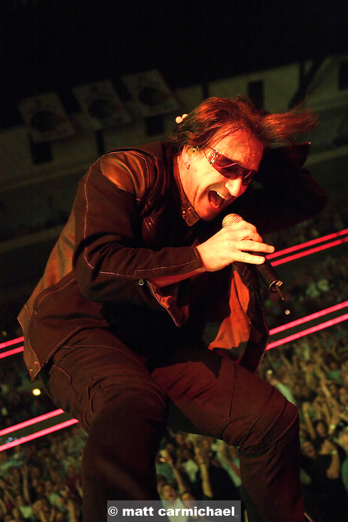 CHICAGO - MAY 09: Bono performs live in concert with U2 on their sold out arena Vertigo tour stop on May 09, 2005 at Chicago's United Center. The shows are being recorded for an upcoming DVD.