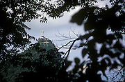 The Christ and Sugarloaf are seen through the trees at Rio de Janiero, Brazil.