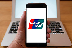 Using iPhone smartphone to display logo of china  UnionPay , Chinese financial services corporation