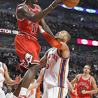 12 March 2012: Chicago Bulls shooting guard Ronnie Brewer (11) passes the ball past New York Knicks center Tyson Chandler (6) during the Chicago Bulls 104-99 victory over the New York Knicks at the United Center, Chicago, Illinois, USA.