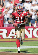 SAN FRANCISCO - SEPTEMBER 17:  Running back Frank Gore #21 of the San Francisco 49ers comes off the field with the ball after scoring a touchdown on a 32 yard  run in the third quarter while rushing for 127 yards on 29 carries against the St. Louis Rams at Monster Park on September 17, 2006 in San Francisco, California. The Niners defeated the Rams 20-13. ©Paul Anthony Spinelli *** Local Caption *** Frank Gore