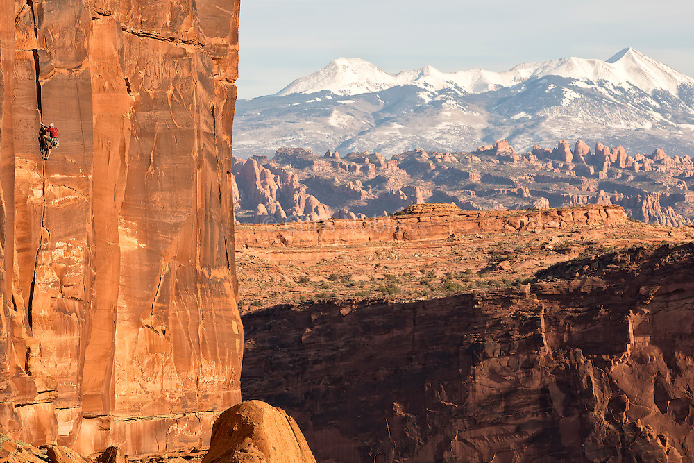 """Jim Donini  at age 72 on the route """"Chasin' Skirt"""" (10+) in Long Canyon near Moab Utah."""