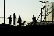 """Roma 7 Settembre 2014<br /> Protesta al Cie di Ponte Galeria contro i lunghi tempi di permanenza nella struttura del centro di identificazione ed espulsione. Gli   immigrati """"ospiti"""" del centro di identificazione ed espulsione sono saliti sul tetto della struttura e gridano: """"Liberi, liberi"""". Un immigrato viene bloccato da un cane poliziotto.<br /> Rome September 7, 2014 <br /> Protest the Center for Identification and Expulsion (CIE) for immigrants from Ponte Galeria in Rome, against the long residence time in the structure of the center for identification and expulsion. Immigrants 'guests' of the center for identification and expulsion climbed on the roof of the structure and cry: """"Free, free.""""  An immigrant is blocked by a police dog"""