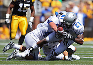 September 4 2010: Eastern Illinois Panthers cornerback Cj James (21) pulls in a fumble during the third quarter of the NCAA football game between the Eastern Illinois Panthers and the Iowa Hawkeyes at Kinnick Stadium in Iowa City, Iowa on Saturday September 4, 2010. Iowa defeated Eastern Illinois 37-7.