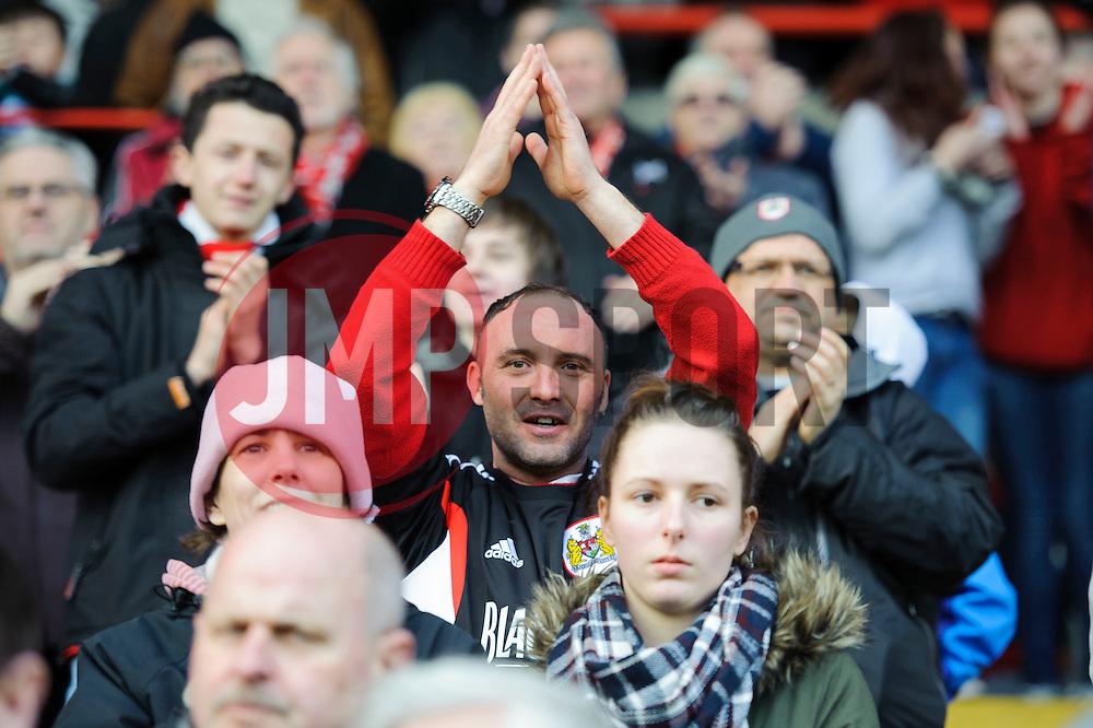 A Bristol City supporter claps after his sides 2-1 win - Photo mandatory by-line: Rogan Thomson/JMP - 07966 386802 - 01/03/2014 - SPORT - FOOTBALL - Ashton Gate, Bristol - Bristol City v Gillingham - Sky Bet League One.