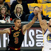 OAKLAND, CA - MAY 31: Stephen Curry #30 of the Golden State Warriors takes a jump shot over George Hill #3 of the Cleveland Cavaliers in Game One of the 2018 NBA Finals won 124-114 in OT by the Golden State Warriors over the Cleveland Cavaliers at the Oracle Arena on May 31, 2018 in Oakland, California. NOTE TO USER: User expressly acknowledges and agrees that, by downloading and or using this photograph, User is consenting to the terms and conditions of the Getty Images License Agreement. Mandatory Copyright Notice: Copyright 2018 NBAE (Photo by Chris Elise/NBAE via Getty Images)
