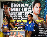 DEC 15,2012. LOS ANGELES,CA. USA. Dec 15,2012. (in blue trunks) .Amir Khan talks at a press conference after going 10 rounds with Carlos Molina Saturday night in the main event at the Sports Arena. Khan, as expected, dominated Molina and stopped him after the 10 th of 12 rounds in front of 6,109 boxing fans..Referee Jack Reiss called a halt to the bout on the advice of Molina's corner, with Khan getting credit for a 10 th-round technical knockout. There were no knockdowns and Khan was ahead by nine points on all three scorecards. Photo by Gene Blevins/LA Daily News.
