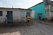 Two boys play table tennis in the streets of Harar, Ethiopia.