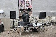 15 March 2013 - Brooklyn, NY. DJ Mojo set the mood of the party in front of Wood's prints of painter Frida Kahlo. 03/15/13 - Photograph by Regina Michelle/The Local