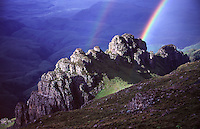 A Double-rainbow forms over the Drakensberg Escarpment, KwaZulu Natal, South Africa