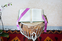 CASERTA, ITALY - 25 FEBRUARY 2015: A bible lays on a djembe in the makeshift altar of the chappel at Casa Rut, a shelter for abused young immigrant women in Caserta, Italy, on February 25th 2015.<br /> <br /> Casa Rut was founded in 1995 and it is promoted and managed by the Ursuline Sisters of the Sacred Heart of Mary of Breganze (Vicenza, Italy).  Casa Rut's goal is to provide young immigrant women a familiar environment where  they are helped to protect and free themselves, and to undertake a common path aiming to the integration in Italy's society.