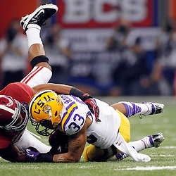 Jan 9, 2012; New Orleans, LA, USA; LSU Tigers wide receiver Odell Beckham (33) is tackled by Alabama Crimson Tide defensive back DeQuan Menzie (24) during the first half of the 2012 BCS National Championship game at the Mercedes-Benz Superdome.  Mandatory Credit: Derick E. Hingle-US PRESSWIRE