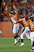 Denver Broncos inside linebacker Brandon Marshall (54) and Denver Broncos inside linebacker Todd Davis (51) celebrate after stuffing a fourth down play in the fourth quarter for a loss of 2 yards to the 50 yard line during the 2017 NFL week 1 regular season football game against the Los Angeles Chargers, Monday, Sept. 11, 2017 in Denver. The Broncos won the game 24-21. (©Paul Anthony Spinelli)