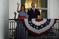 July 4, 2018 - Washington, District of Columbia, U.S. - United States President Donald J. Trump and First Lady Melania Trump react from the Truman Balcony of the White House during a fireworks display in Washington, D.C. (Credit Image: © Yuri Gripas/CNP via ZUMA Wire)