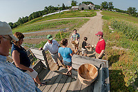 John Moulton brings the Daggett family out into the fields to pick cucumbers, squash, corn, green beans and yellow beets during Moulton Farm's Little Sprouts Garden program on Wednesday morning.  l-r John Petty, Judy Daggett, John Moulton, Abby, Bridget, Jason and Jim Daggett.  (Karen Bobotas/for the Laconia Daily Sun)