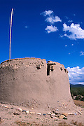 Ruins of an adobe kiva (ceremonial chamber) above Picuris Pueblo, New Mexico .