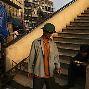 Daily life at Dong Xuan Market, the largest market in Hanoi, Vietnam.