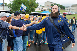 Sep 12, 2015; Morgantown, WV, USA; West Virginia Mountaineers punter Nick O'Toole arrives at Milan Puskar Stadium before their game against the Liberty Flames. Mandatory Credit: Ben Queen-USA TODAY Sports