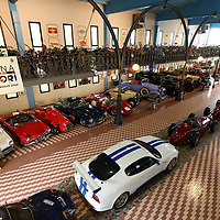 View from the balcony to Maseratis, Alfa Romeos, Stanguellini, Mercedes-Benz at the Museo Panini, Modena, Italy, 2014
