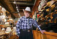 "Jack A. Weil, 105 years old, smiles amopung his hat designs in his office and shop in downtown Denver, Colorado April 7, 2006. The founder of Rockmount Ranch Wear is the oldest and longest-serving CEO in the U.S.. His clothes has become a mainstay for celebrities and politicians and his collection was worn in the movie ""Brokeback Mountain"" with a shirt worn in the film selling recently for over $100,000 on eBay. Weil was the first with a soft brimmed cowboy hat designed he said, so that three cowboys could ride together in the front of a pickup truck without knocking their hats off. PHOTO TAKEN APRIL 7, 2006. REUTERS/Rick Wilking"