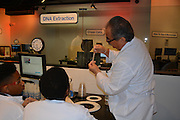 Dr. Perez helps Mickey Leland ninth-grade biology students extract DNA in the Health Museum's DeBakey Cell Lab.