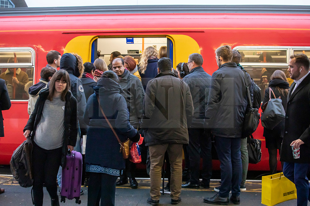© Licensed to London News Pictures. 16/12/2019. London, UK. Commuters faced queues and more delays at Clapham Junction this morning as a new National Rail winter timetable comes into effect along with the on going RMT strike on South West Rail services now in its third week. Photo credit: Alex Lentati/LNP
