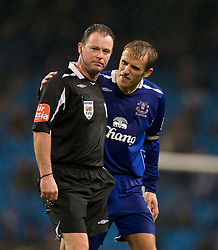 MANCHESTER, ENGLAND - Monday, February 25, 2008: Referee Rob Styles shows the red card to Manchester City's Martin Petrov (not shown) as Everton's Phil Neville looks on during the Premiership match at the City of Manchester Stadium. (Photo by David Rawcliffe/Propaganda)